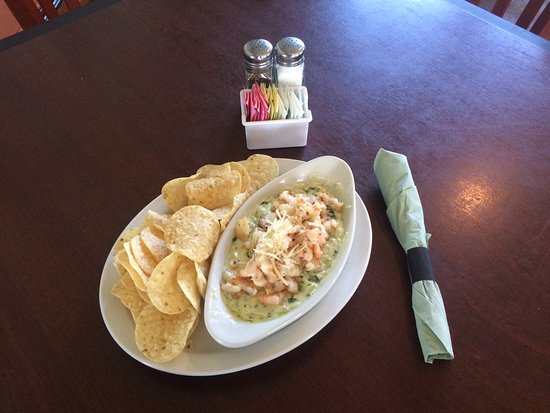 Fredericktown, MO: Spinach Artichoke Dip topped with sautéed shrimp.