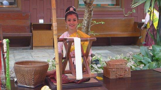 Pretty Thai girl weaving silk at Jim Thompson's  - Picture