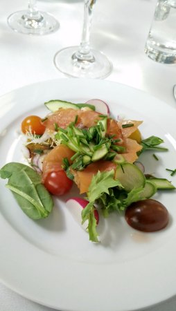 Hoejby, Denmark: For dinner we got salmon for an appetizer, served on fresh vegetables from local raw materials.