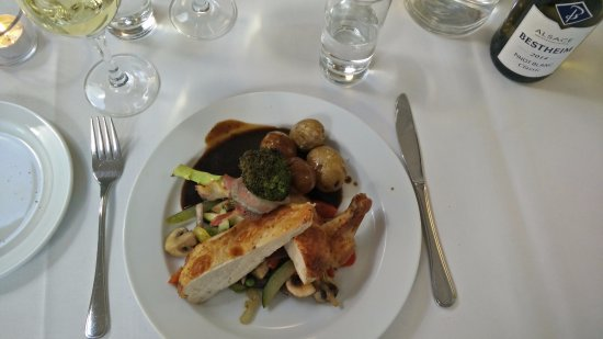 Hoejby, Denmark: ell prepared chicken with raw fried potatoes with a crispy bacon wrapped broccoli.
