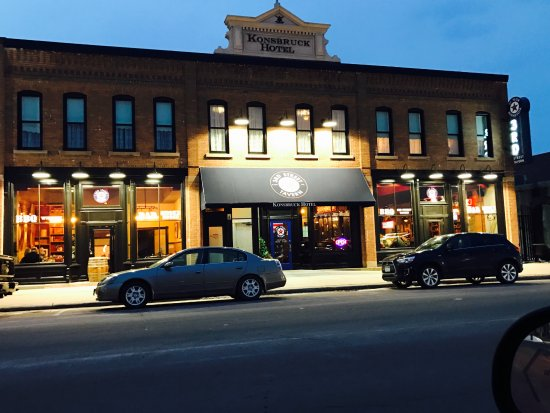 Saint Peter, MN: Night view of 3rd St and Konsbruck Hotel