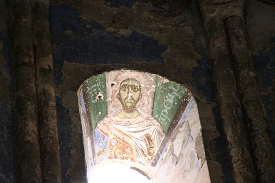 Ishan Church: One of the saints in a window of the drum