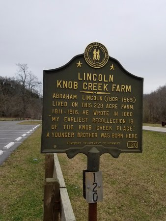 roadside sign at boyhood home picture of abraham lincoln