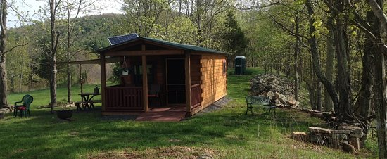 Franklin, WV: Rustic camping cabin with picnic area on left, private patio on right