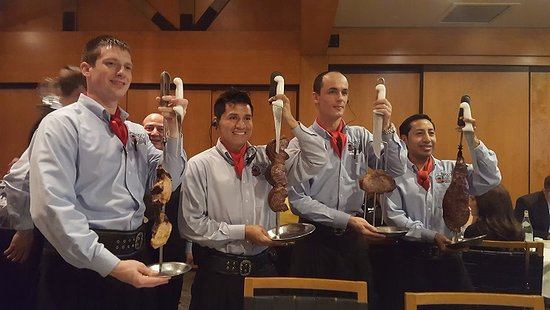 Fogo de Chao Brazilian Steakhouse: Waiters showing off their meat