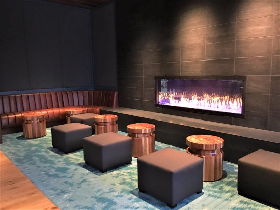 The new bar and fireplace decor right off the atruim.