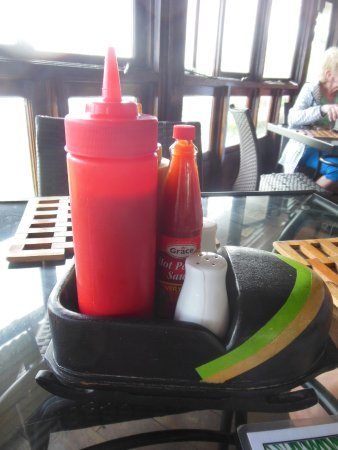 Mystic Dining Restaurant and Bar : Condiments in a bob sled