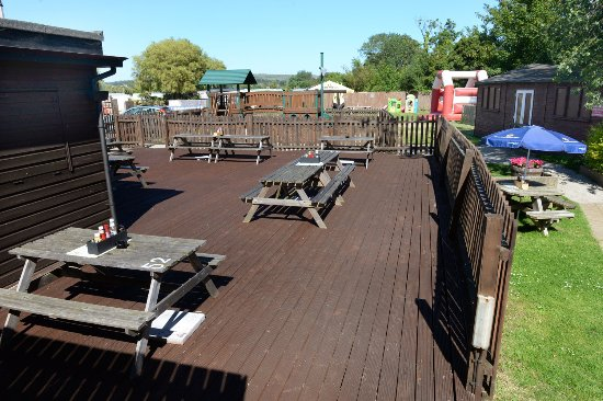 The Caulkheads: Decking And Rear Garden With Bouncy Castle And Kids Pirate  Ship!