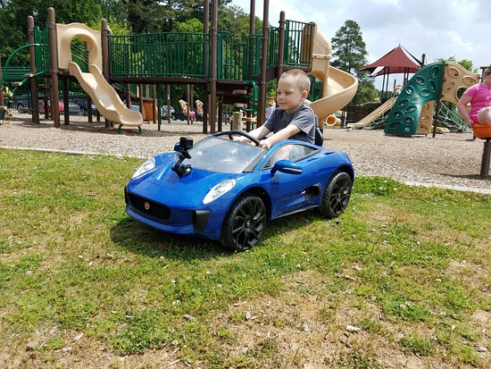 Acworth, GA: Huge playgrounds and plenty of field for play (or in our case power wheels)