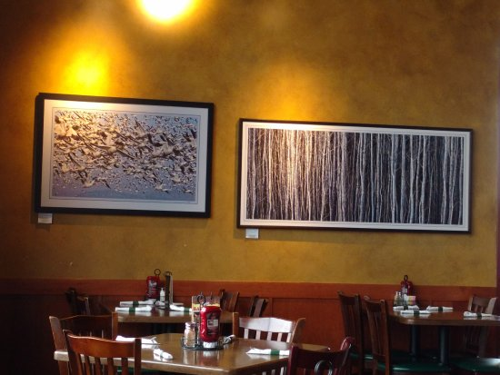 the main dining room has nice art work on the walls picture of