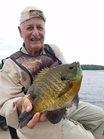 Avon, MN: Robert with a trophy bluegill from an adventure with Slab Seeker Fishing!
