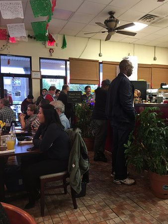 East Brunswick, NJ: Crowd waiting to be seated and getting takeout.