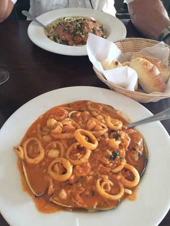 Cuero, TX: Seafood and pasta dish and Salmon with capers and lemon sauce both delicious.
