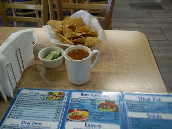 San Ysidro, CA: Chips, lime, and a cup a fish soup