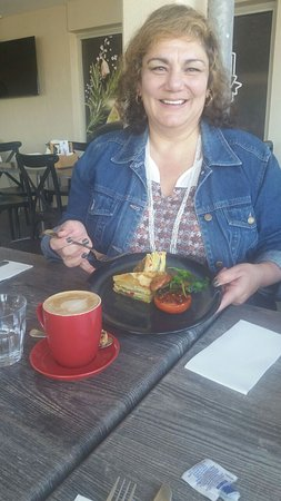 Mindarie, Australia: Spanish Egg Tortilla - fine layers of potato and veges with a side of chorizo and fried tomato H