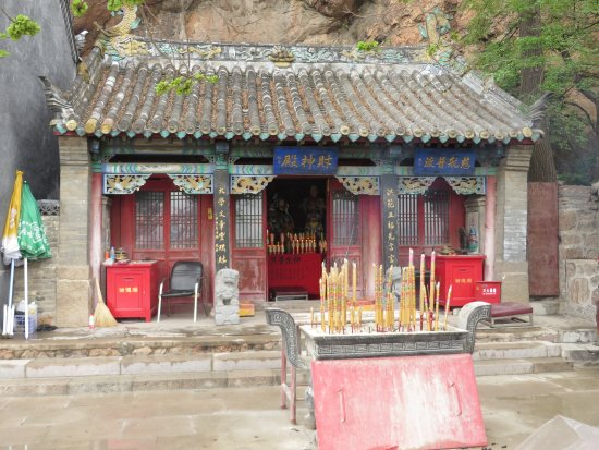 Anshan, China: Temple nestled beneath 5 Buddha Peak