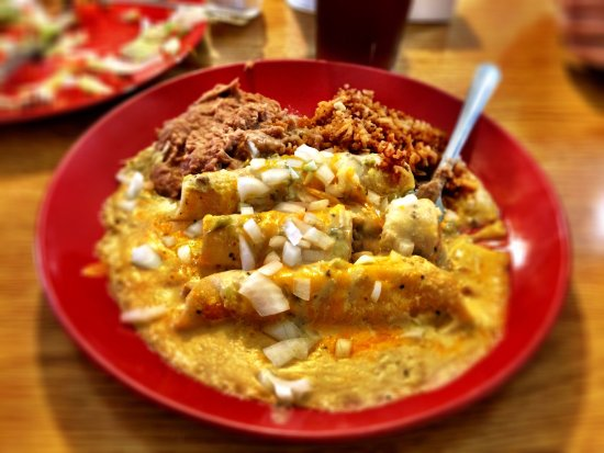 Sanderson, TX: Meme's Green Chile Chicken Enchiladas with onions.