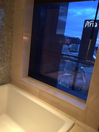 the of las vegas autograph collection japanese soaking tub in bathroom overlooking strip