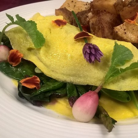 The Looking Glass Restaurant : Garden of Eden Omelette- Maine Family Farm Eggs filled with Farmer's Market Produce