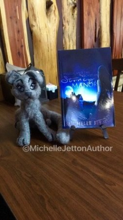 """Cave Spring, GA: Luna and my book, """"Amelia and the Secret of Stoney Manor"""" on the table at Creekside Restaurant."""
