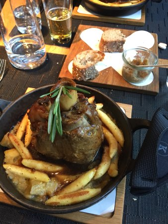 Kohlmanns: Schweinshaxe with soggy french fry looking noodles, soaked in a wine sauce.