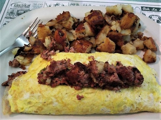 Newington, CT: Hash & cheese are inside the omelet, then more hash on top plus potatoes on the side.