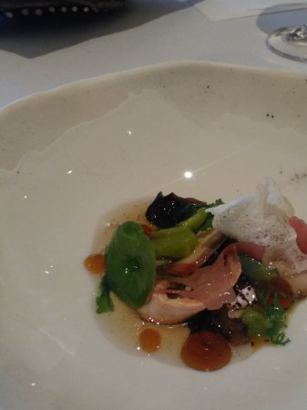 Gidleigh Park Restaurant : 'Umami' perfect chicken with garlic pan a cotta, frozen lovage and tapioca crackers