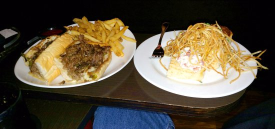 Cinebistro at Stony Point Fashion Park : Ribeye cheese steak on left. A little lobster and a lot of potato on the right.