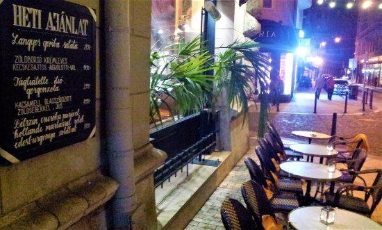 Centrál Kávéház és Étterem: The patio at night to the other hand with the Hungarian menu