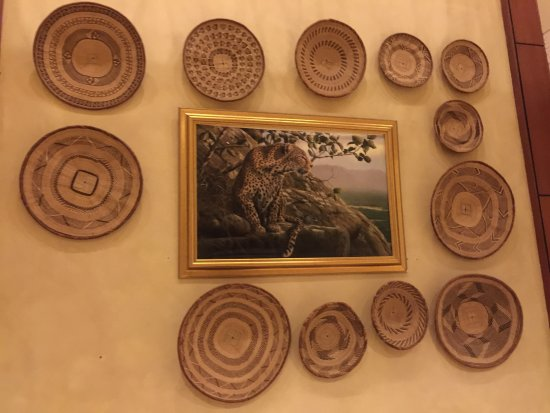 Elephant Hills Resort: Beautiful artwork adorn the walls, pictured here African wildlife.