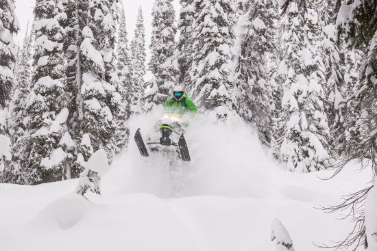 Guide Aaron Bernasconi pillow popping in Quartz Creek with Golden Snowmobile Rentals.  PC: Tim G