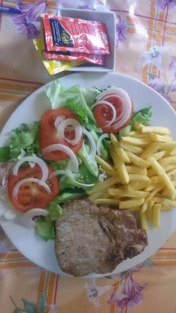 PORK GRILLED  WITH FRENCH  FRIES, TOMATOES & SALAD...