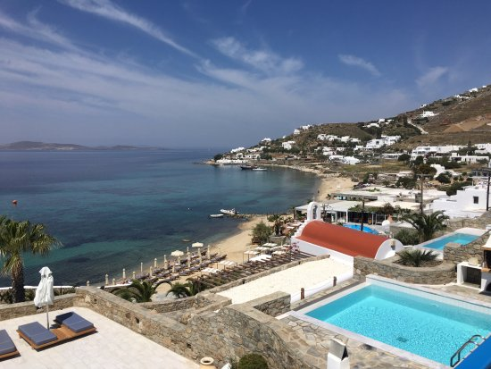Mykonos Grand Hotel & Resort : The beach which is less than 5 minutes away, the sunbeds belong to the hotel.