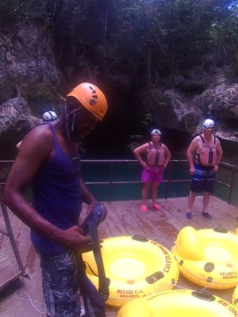 Cave Tubing.Bz: Prepping for our float. Bottomed tubes are tied together in a pod.