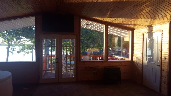 Grove, OK: Cabin 25 - view through to deck at sunrise