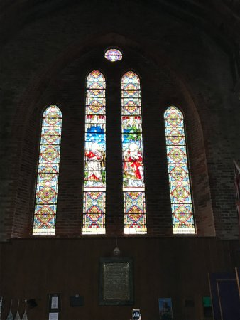Whalebone Arch: Stained glass windows in back of church