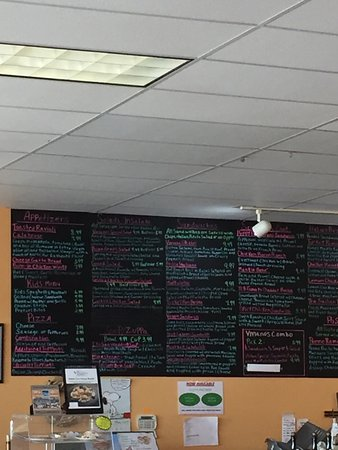 Fenton, MO: Join the Text Club.  1/2 eaten Cannoli - Yum The Menu Board. Food is great and Mike the owner kn