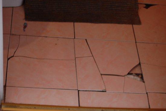 Loose And Broken Floor Tiles