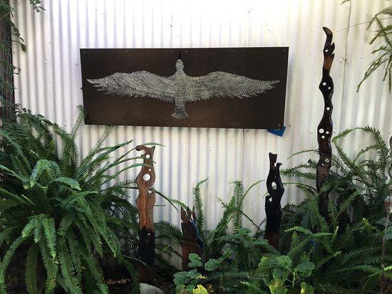 Pohara, New Zealand: Plasma cut, powder coated steel painting for outside areas. Burnt wooden rimu totems.