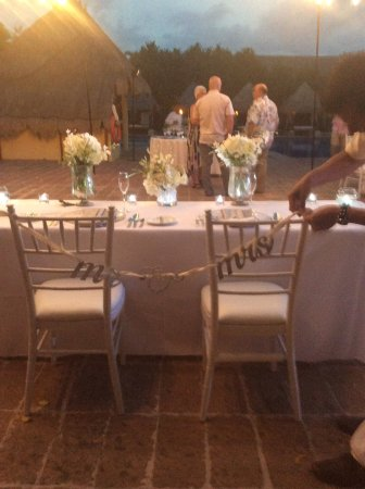 Sweetheart table setup for the bride and groom at the wedding ...