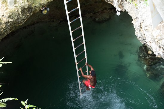 Blue Hole Mineral Spring Diver Climbing Out Of Blue Hole