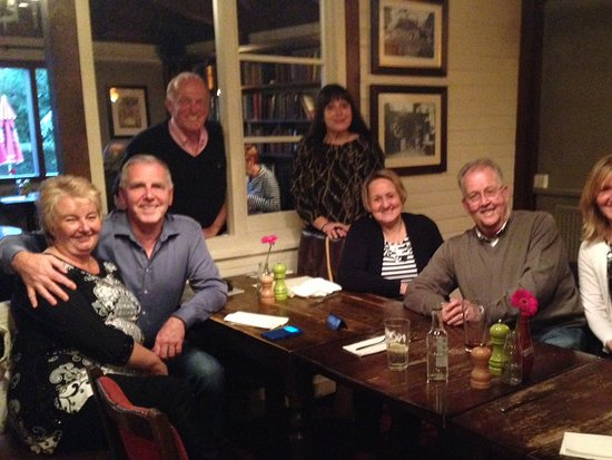 Waterlooville, UK: Friends enjoying a Red Lion evening
