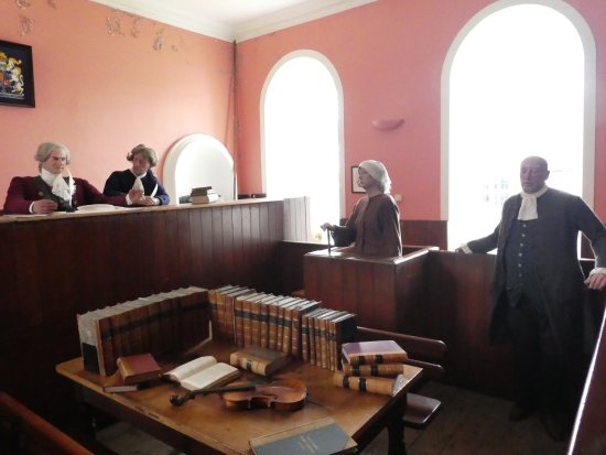 Cromarty, UK: Female witness in the stand. Note period costumes worn by mannequins. Costumes provided for phot