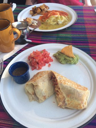 The Sand Bar: Egg & Chorizo Burrito & Divorciados Eggs. House made salsa in the blue tin cup!