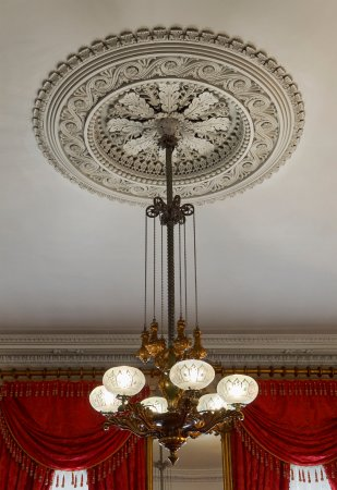 Merchant's House Museum: One of a pair of gas chandeliers, ca. 1855, in the Greek Revival double parlor