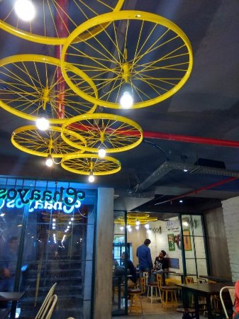 chaayos celing lights made from cycle wheels