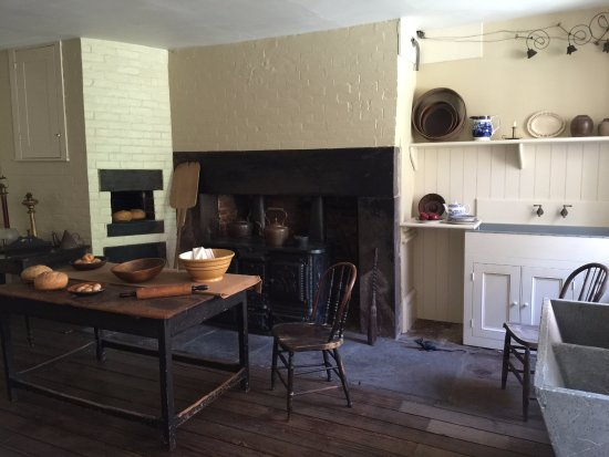 Merchant's House Museum: 1850s kitchen with bee-hive oven, cast-iron stove, and servant call bells.