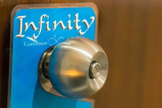 Infinity Guesthouse: Logo Door hanger
