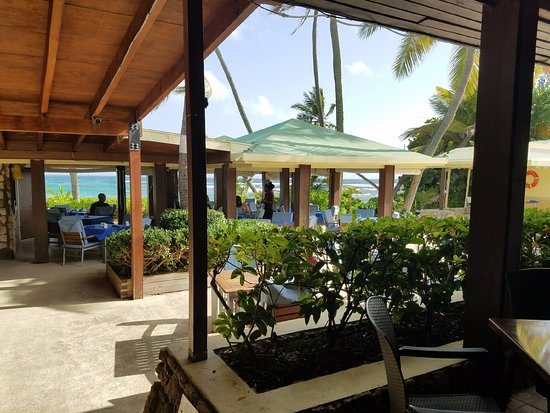 The Palms at Pelican Cove: From the Mahogany Bar, looking to the Beachside Dining Pavilion