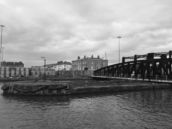 Goole, UK: View towards hotel from other side of dock. Ship entering dock via lock. Big metallic dinosaur a